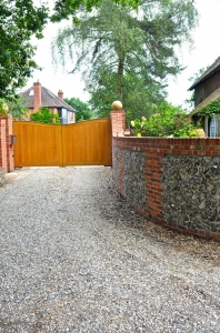 Curved_brick_and_flint_wall_and_driveway